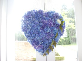 Hearts suspended from door handles, from windows and above tables
