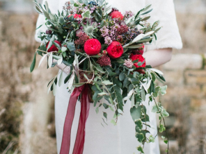 Winter styling soft trailing foliage and red Roses